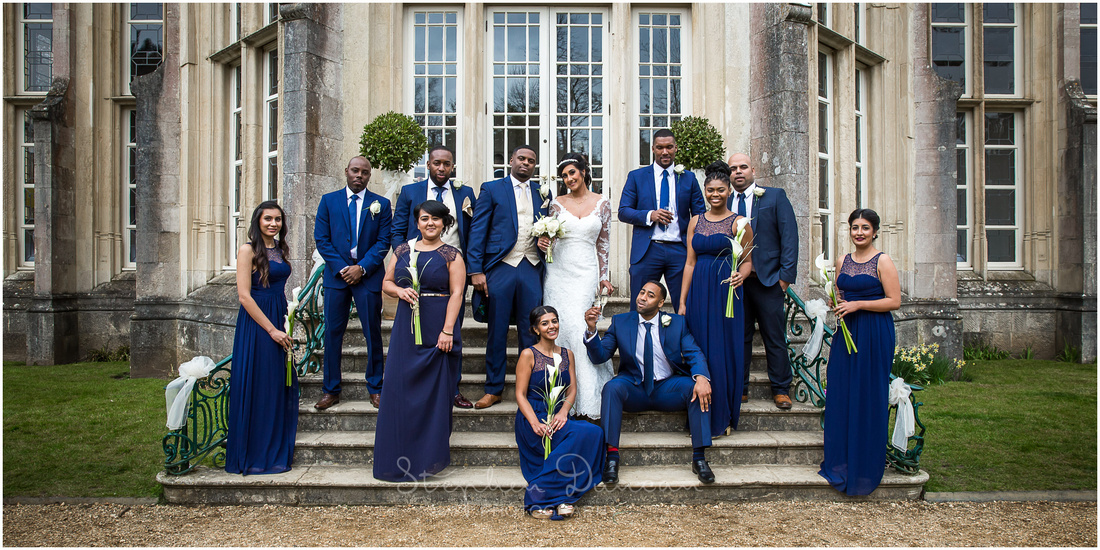 Formal photograph of bride, bridesmaids, groom, best man and ushers