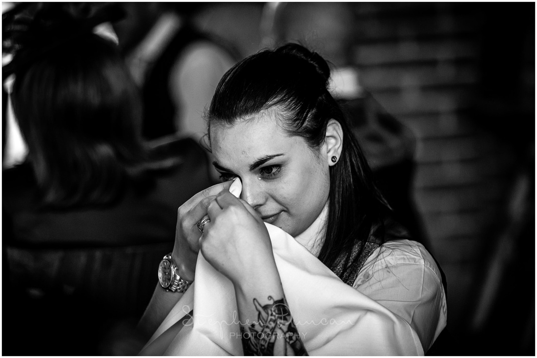 A guest wipes away a tear during the speeches