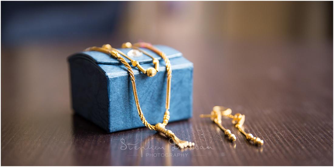 Close-up photograph of gold bridal wedding jewellery