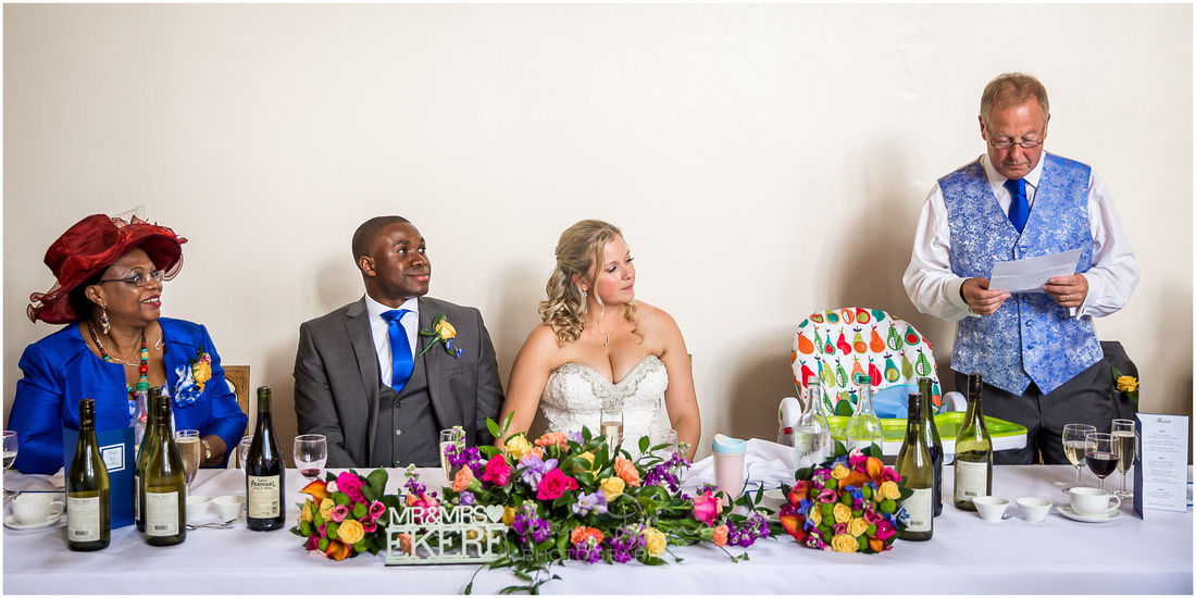 The father of the bride makes his wedding speech at the top table