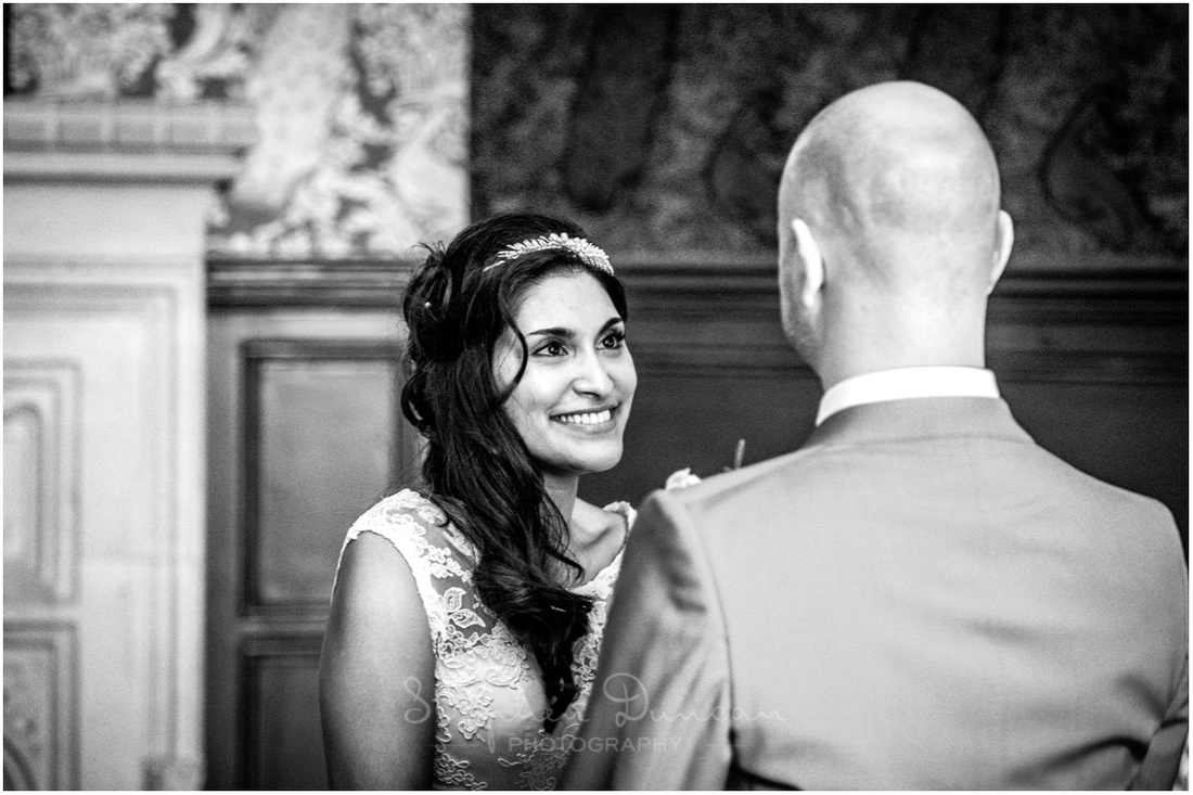 The bride looks at her groom at the start of the marriage ceremony