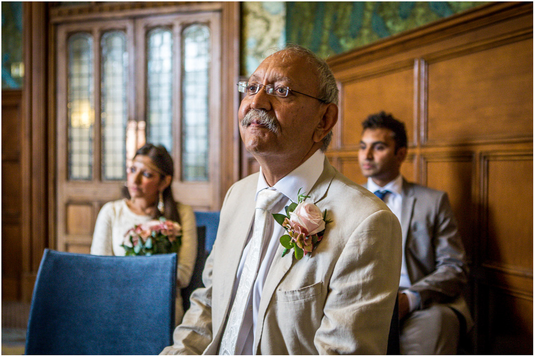Bride's father watches on during the wedding ceremony at Winchester's Castle Complex