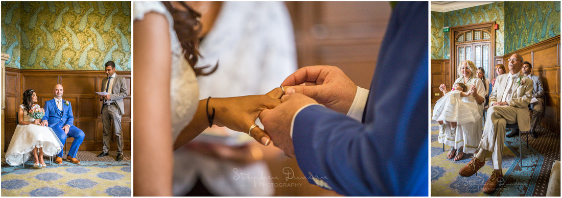 The groom places the wedding ring on the bride's finger
