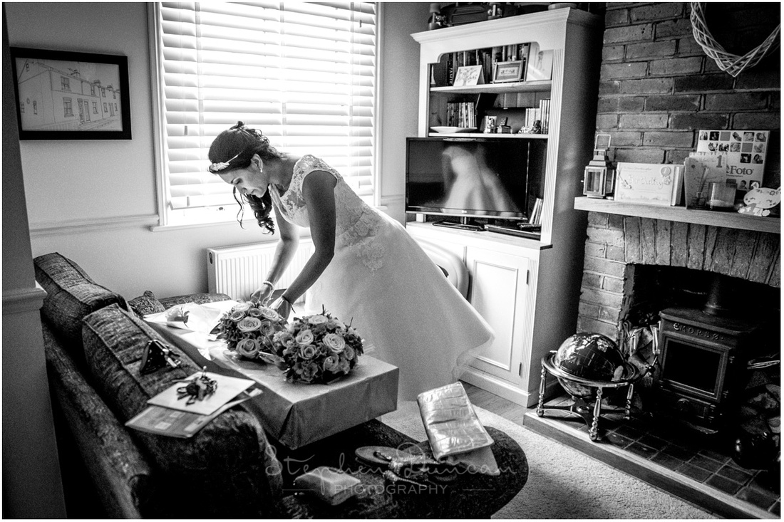 Candid moment of bride checking the flowers during the bridal preparation