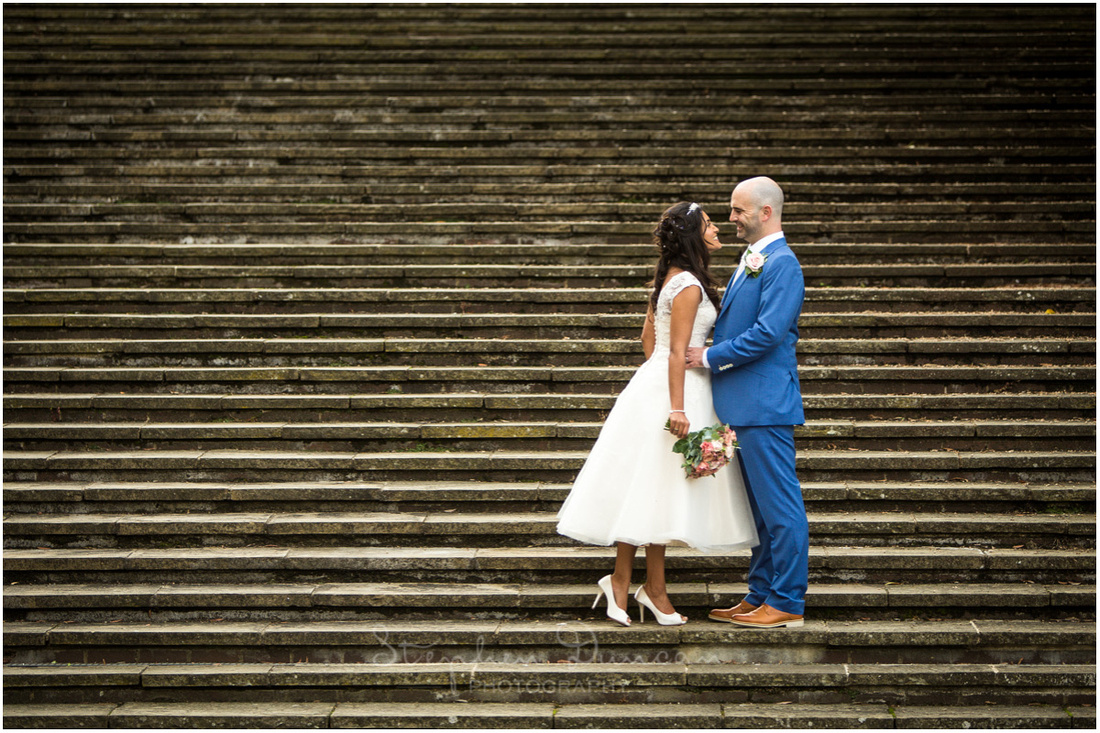 Bride and groom on the steps outside the law courts, next to the Great Hall