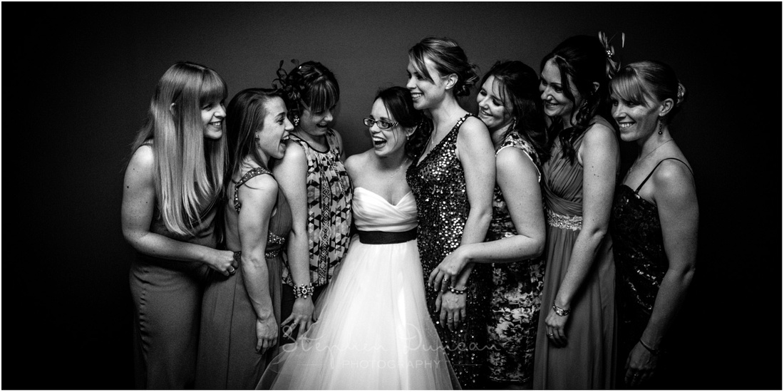 Black and white photo of bride with friends