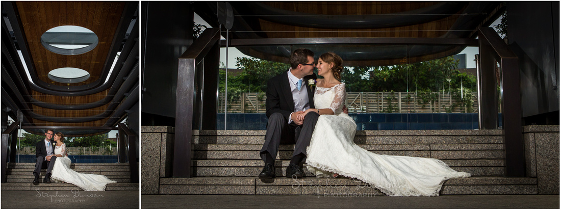 Flash-lit evening photos of bride and groom outside restaurant entrance in early evening light