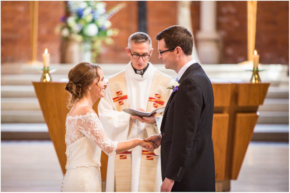 The bride and groom turn to face each other to make their wedding vows