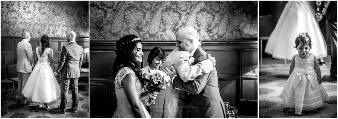 The groom and the father of the bride share a hug