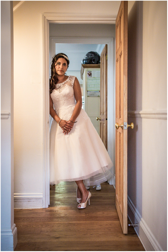 Portrait of bride in house before leaving for ceremony
