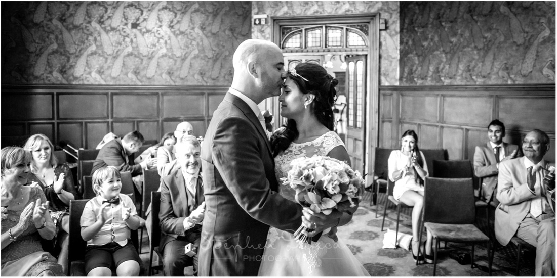 Bride and groom kiss after being announced as husband and wife