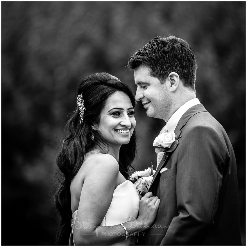 Couple posing at Winnall Moor in Winchester for wedding photos