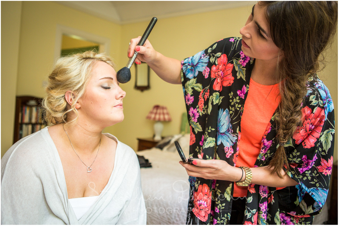 Bride has some make-up applied