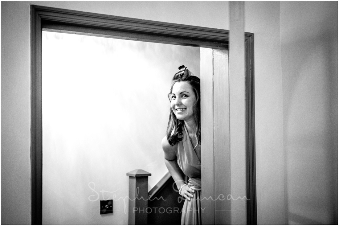 A bridesmaid caught sneaking downstairs to check whether the groom had arrived