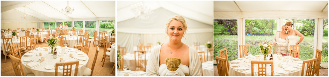 The bride casts her eye over the decoration of the marquee