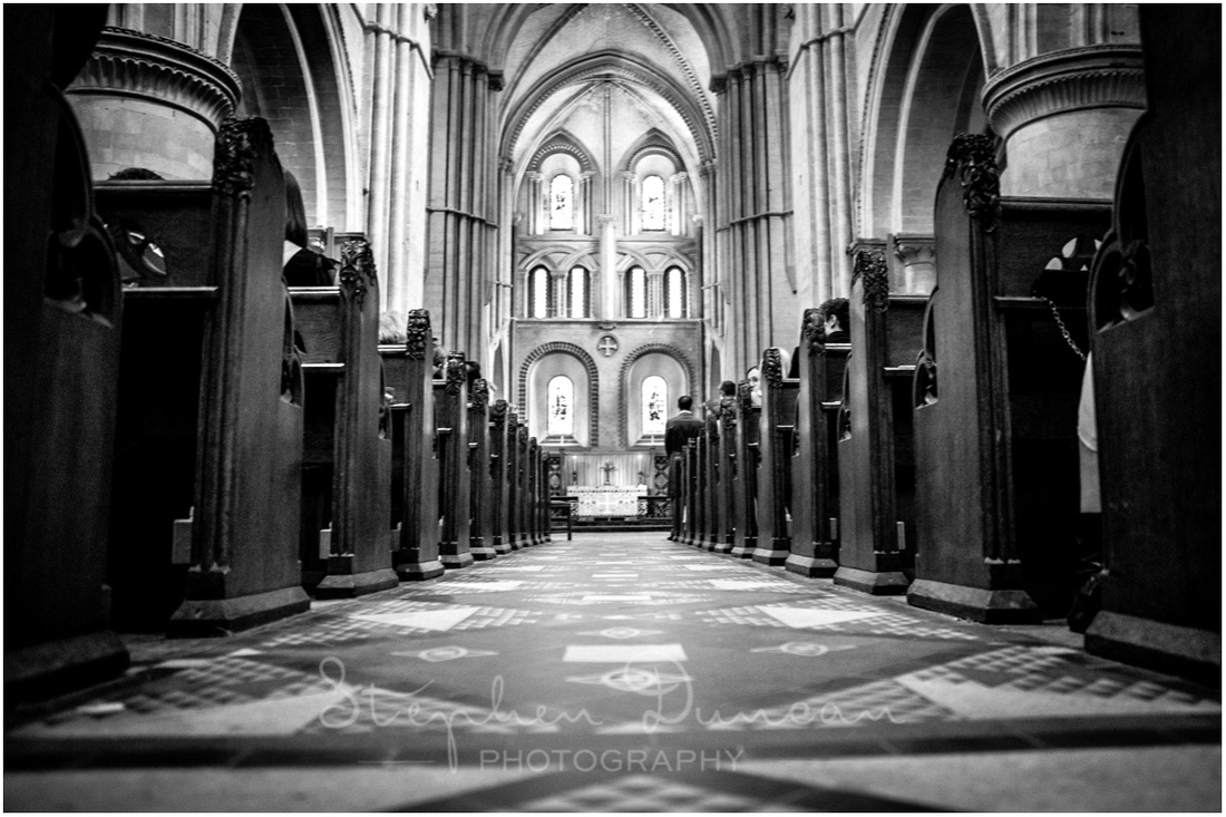 The central aisle with groom waiting at the end just before the bride walks to the front on her father's arm