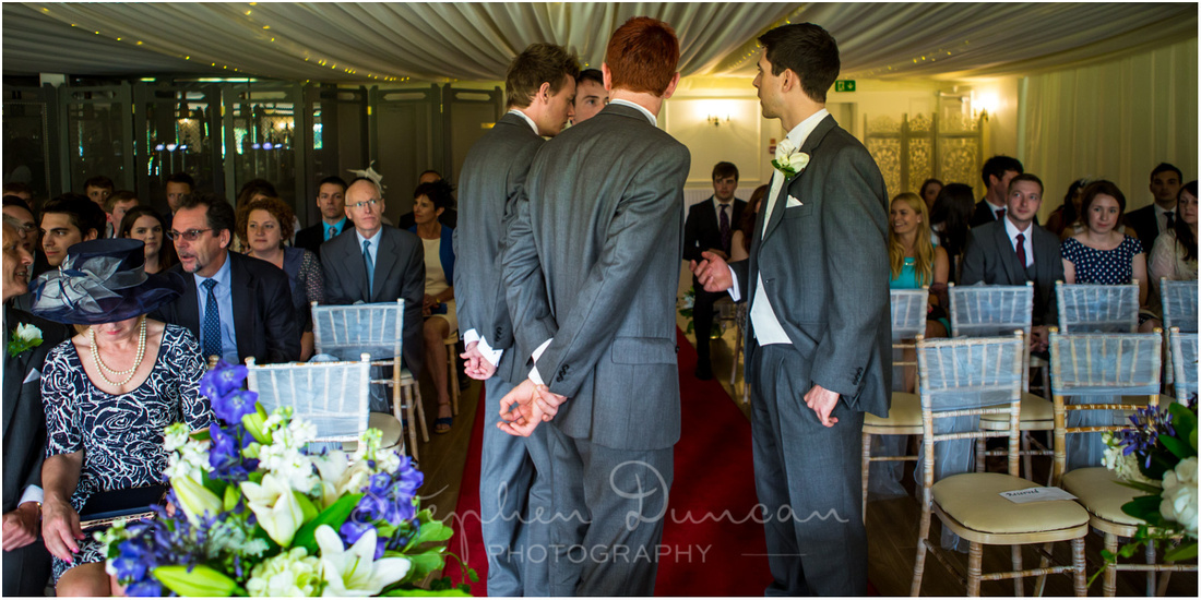 Groom waiting as guests take their seats ready for the marriage ceremony