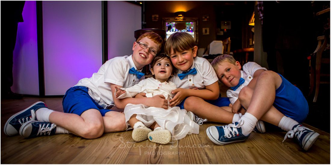 Children pose for a relaxed portrait at wedding reception at Winchester Corner House