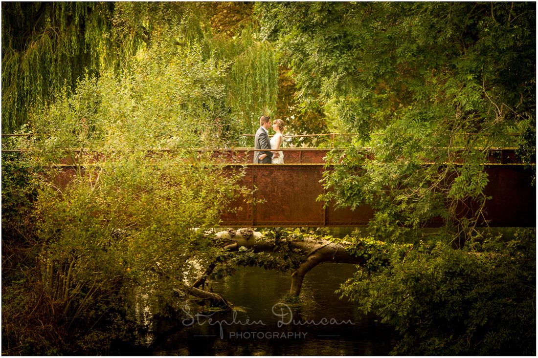 Colour photo of couple on bridge