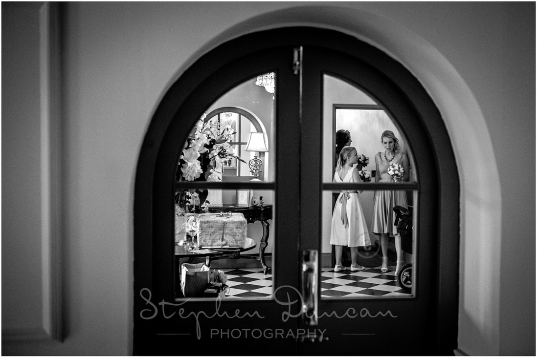 Bridesmaids making final preparations in the lobby room before the bride makes her entrance