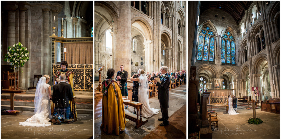 The newly-married couple receive the wedding blessing at the front of the church