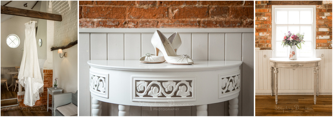 Wedding dress and bride's shoes arranged in one of the ground-floor rooms