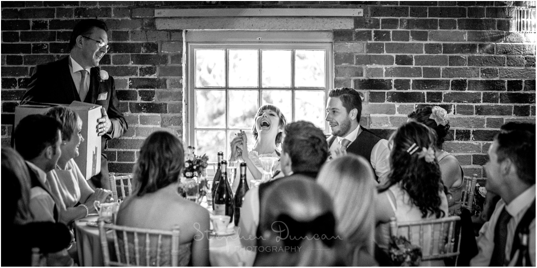 Bride reaction during father of the bride wedding speech at Sopley Mill