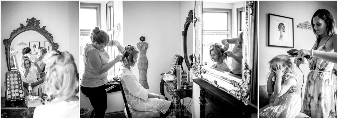The bride works on her hair and make-up as a flower girl begins her own preparations