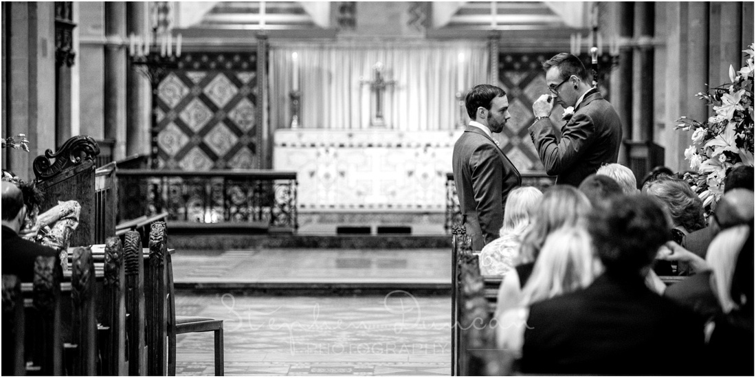 Groom and best man stood at the front of the church waiting for the bride to arrive