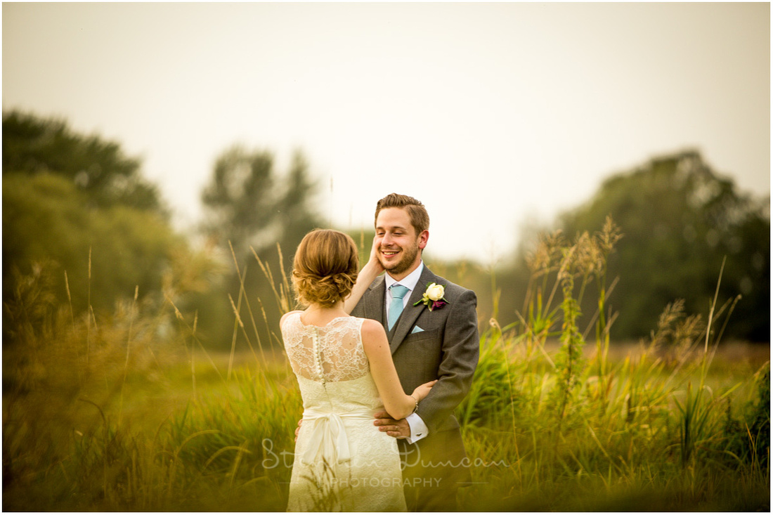 Golden hour sunshine photo of couple together near Sopley Mill