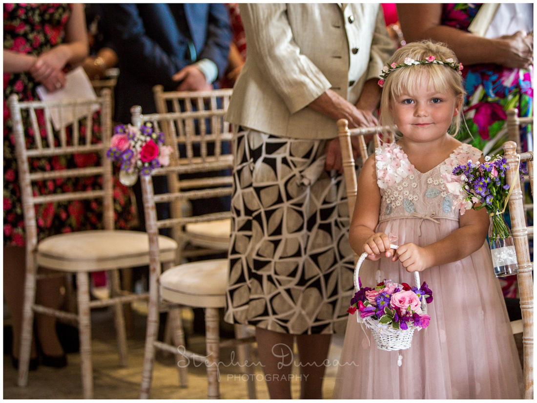 Flower girl during wedding at Sopley Mill