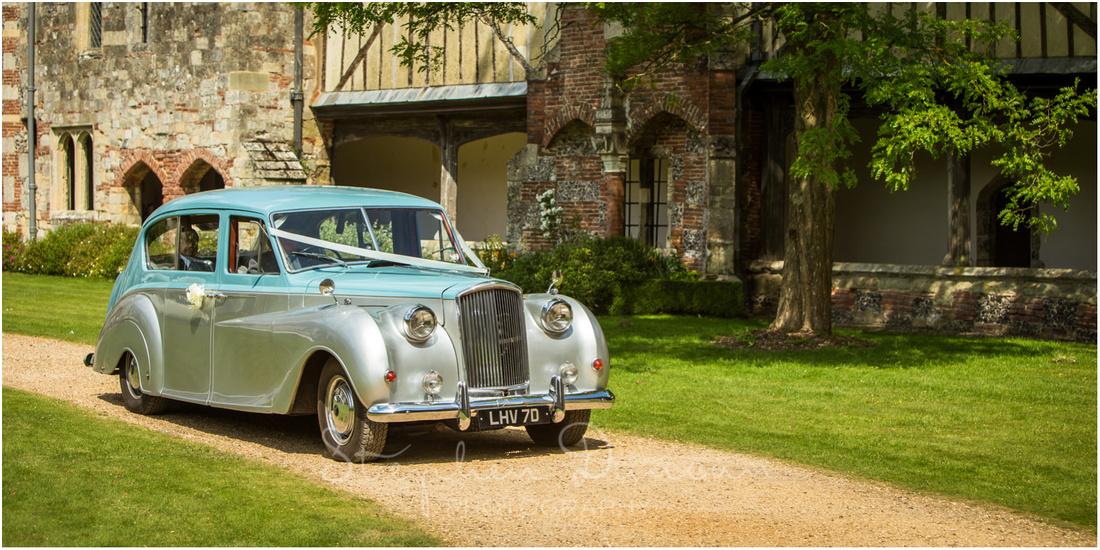 The Rolls Royce pulls up inside the quadrangele