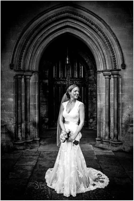 Portrait of bride outside door to church
