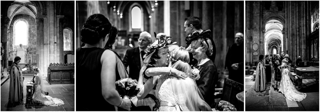 The bride and groom's families see them for the first time after the marriage as they gather to sign the registers