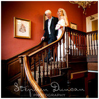 Father of the Bride and Bride on stairs at Audleys Wood