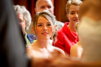 Winchester Guildhall Wedding Photography: Guest watches the exchange of rings at wedding ceremony