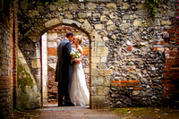 Winchester Guildhall Wedding Photography: Bride and Groom embrace under archway near Winchester Cathedral