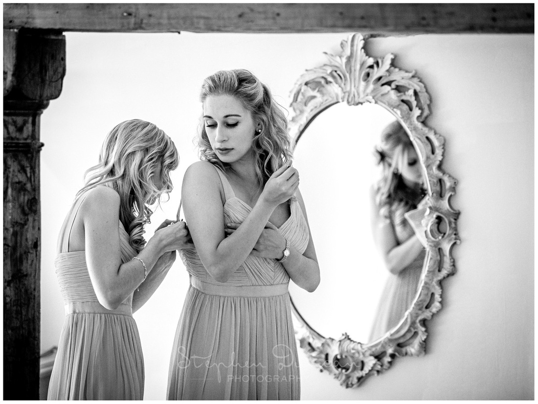 Bridesmaids getting ready in front of mirror in the dressing room