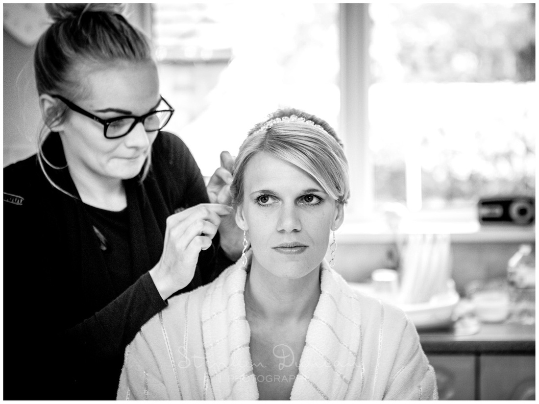 Finishing touches applied to bride's hair