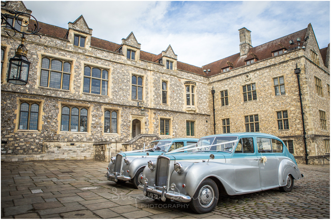 The wedding cars parked outside the Great Hall