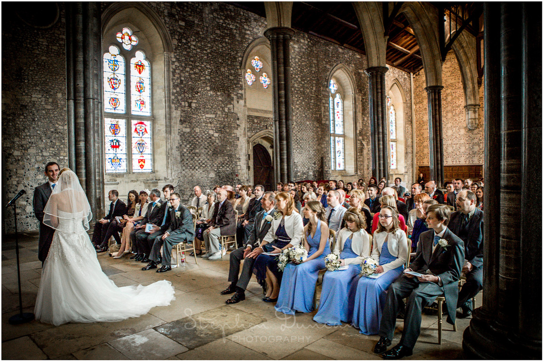 The bride and groom make their vows in the Great Hall as friends and family watch on