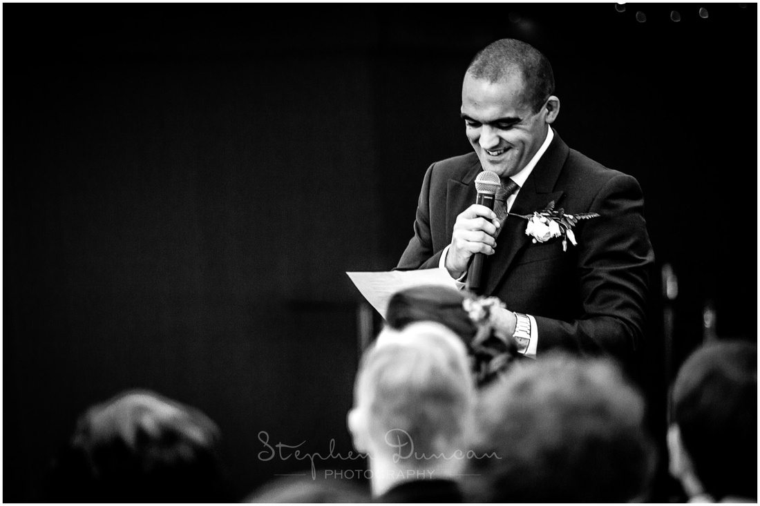 The groom stands to make his wedding speech
