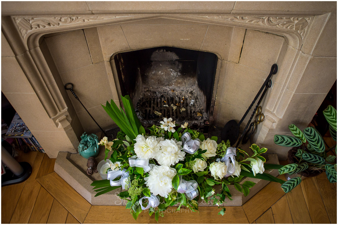 Floral details arranged in fireplace