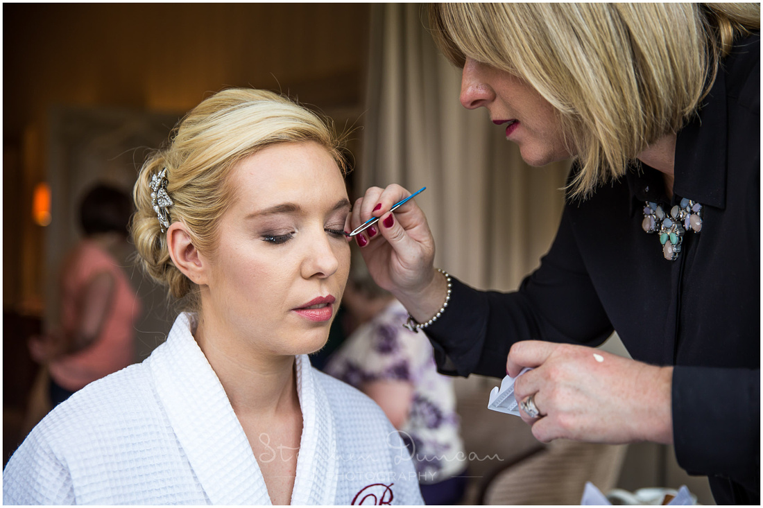 Pamela Moss make-up artist applies make-up to bride in the morning