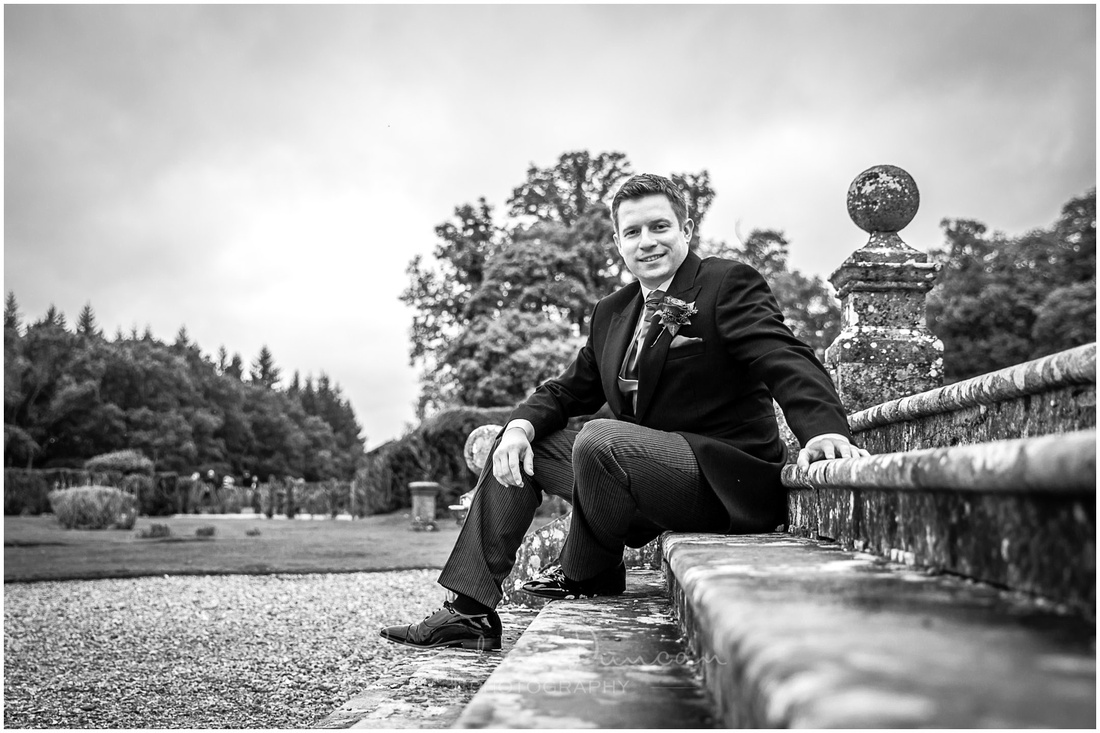 Groom portrait on hotel garden steps