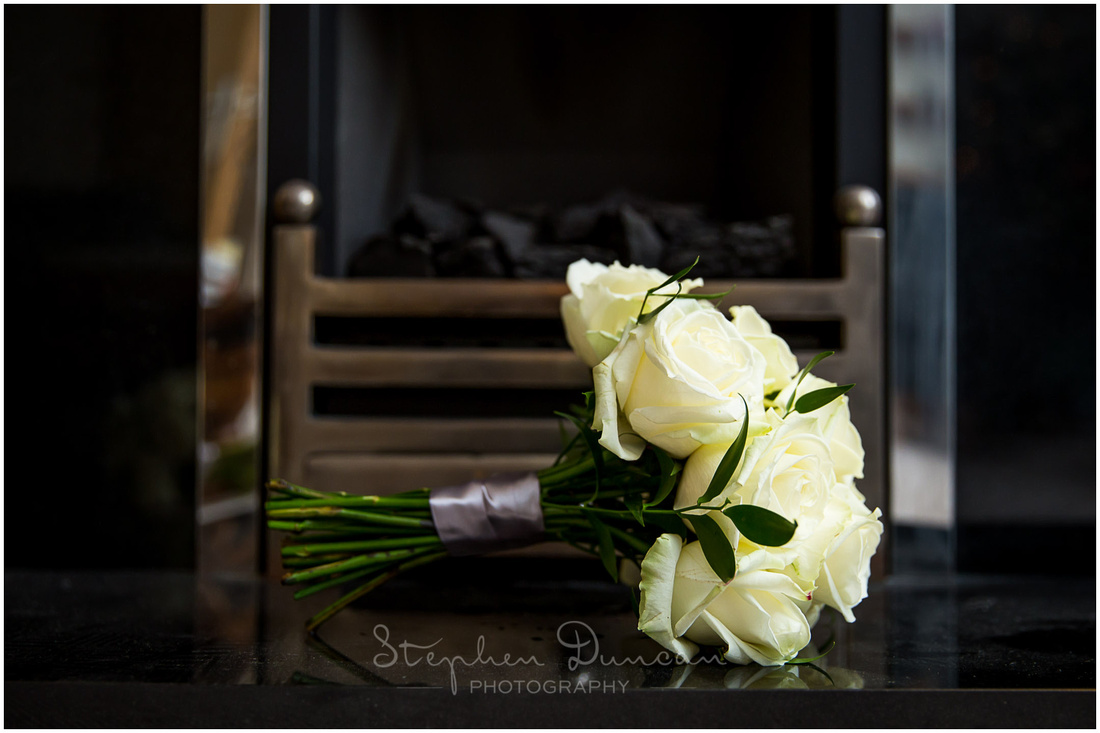 Detail of bouquet in front of fire place