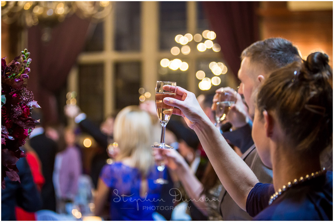 Guests raise a glass to toast the bride and groom