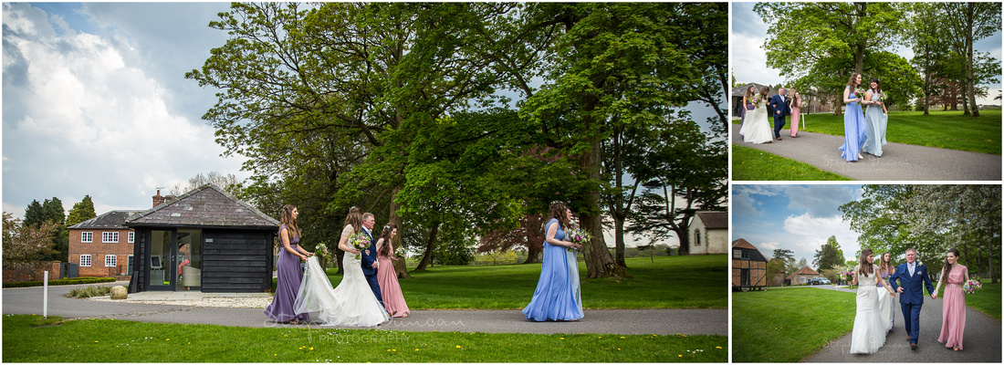 The bride and bridesmaids make the short walk through the estate's grounds from the bridal suite to the ceremony room, accompanied by the bride's father