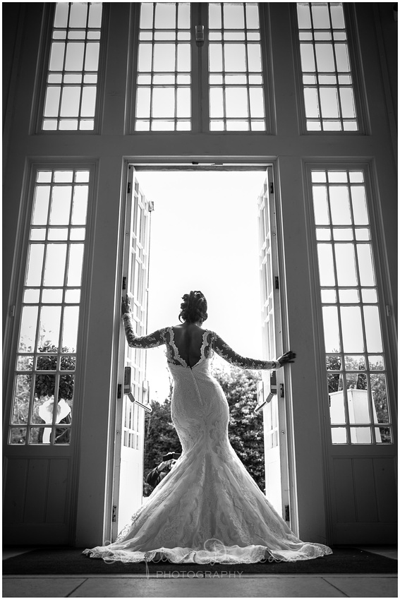 Bride posed against doorway