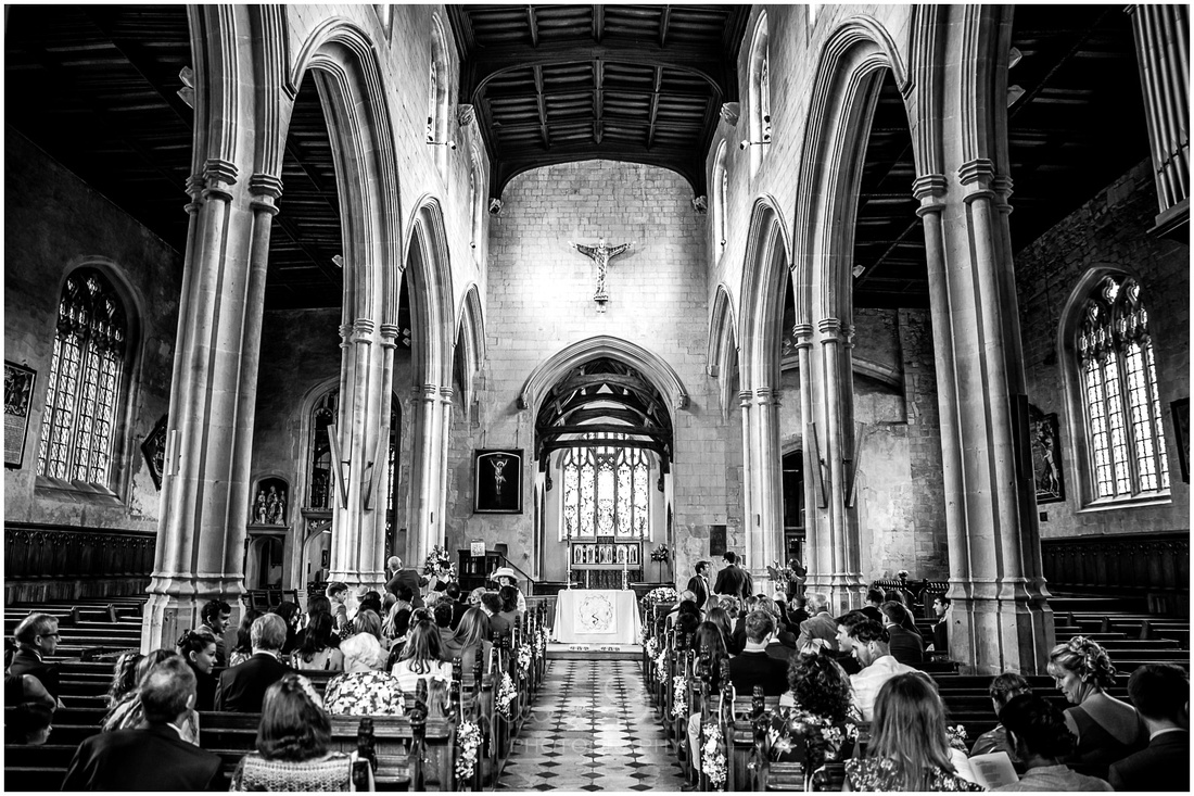 Wide view of St Michael's Church looking down the aisle towards the altar from the West door